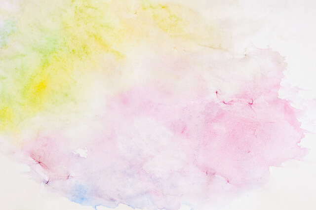 Light background paper texture in soft shades of spring colors in blur style. Abstract watercolor